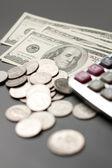 Dollar coin and a calculator — Stock Photo