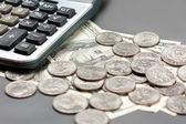 Dollar coin and calculator — Stock Photo
