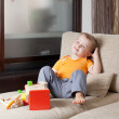 Adorable boy siiting with wooden building toys at home — Stock Photo