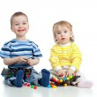Happy children boy and girl playing together with mosaic toy — Stock Photo