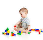 Cheerful child boy playing with construction set over white background — Stock Photo