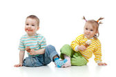 Happy children little girl and boy eating ice-cream on white bac — Stock Photo