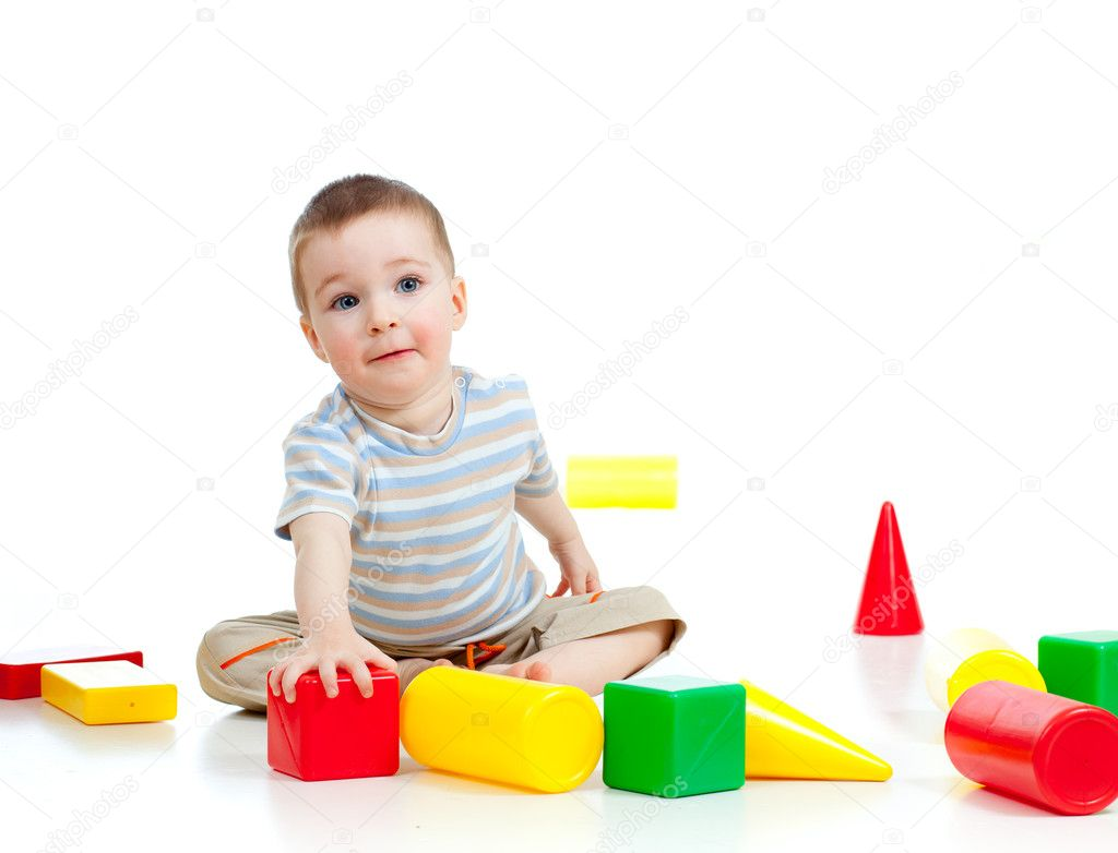 Smiling child playing with colorful building blocks or bricks — Stock Photo #10181738
