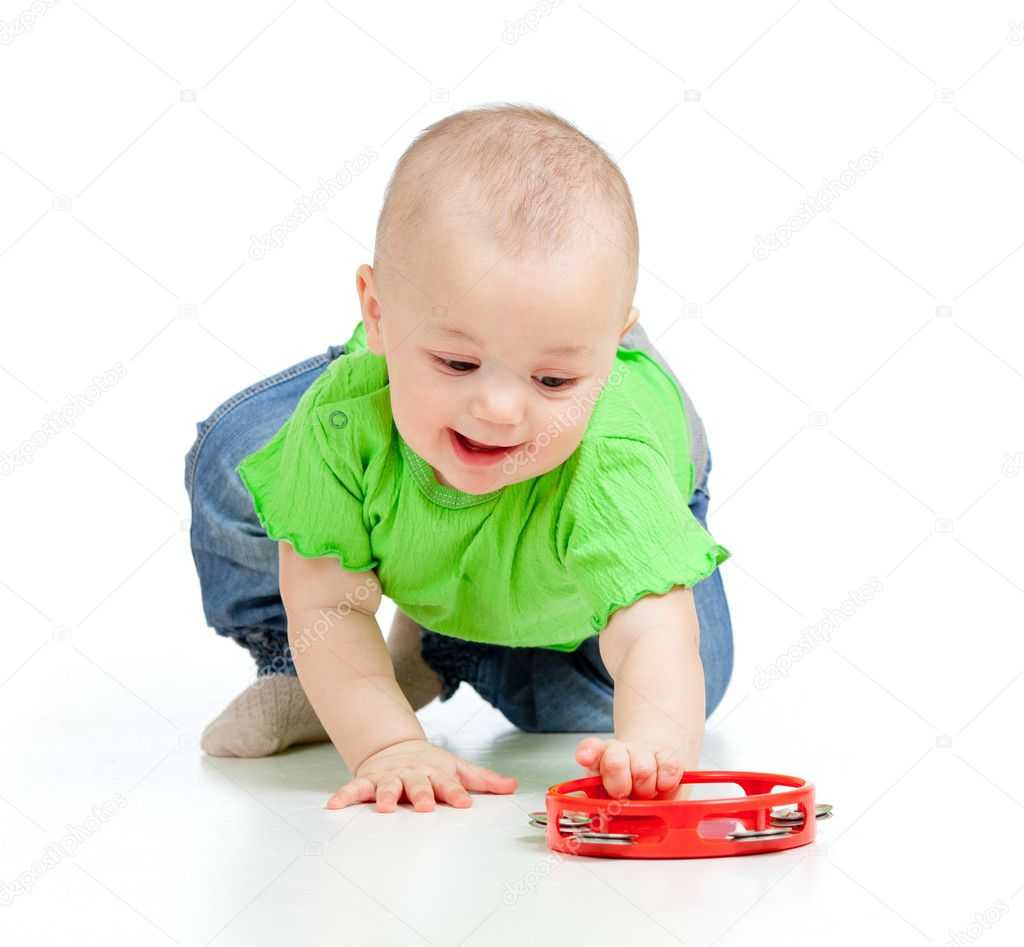 Child playing with musical toy. Isolated on white background — Stock Photo #10181800