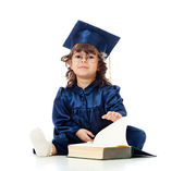 Little girl child in academician clothes with book — Stock Photo