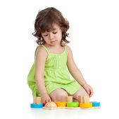 Funny little child playing with colorful toys, isolated over whi — Stock Photo