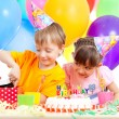 Adorable children celebrating birthday party and opening gift bo — Stock Photo #10413101