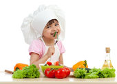 Chef girl preparing and tasting healthy food over white backgrou — Stock Photo