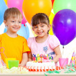 Smiling children celebrating birthday party - Stock Photo