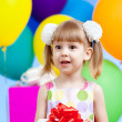 Royalty-Free Stock Photo: Girl  with colorful balloons and gift