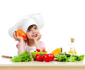 Chef girl preparing healthy food vegetable salad over white back — Stock Photo