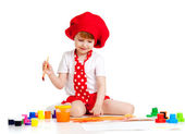 Small artist child painting with brush — Stock Photo