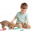 Kid drawing felt pens with cat — Stock Photo #10564368