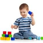 Kid playing toy blocks — Stock Photo