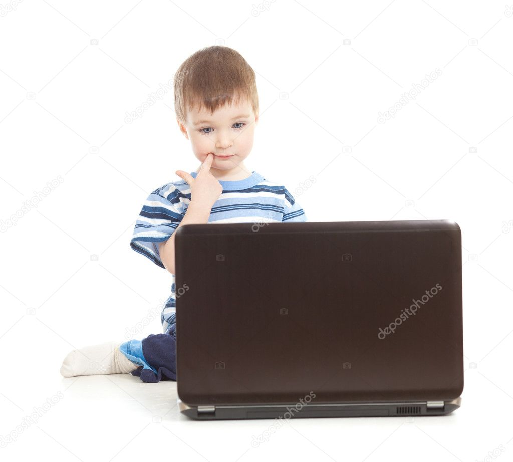 Serious kid with notebook on white background — Stock Photo #10568841
