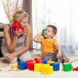 Cute mother and kid boy playing together indoor — Stock Photo #10661152