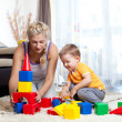 Cute mother and kid boy playing together indoor — Stockfoto