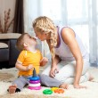 Loving mother kissing her child boy together indoor — Stock Photo