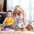 Mother, child boy and pet dog playing together indoor — Stock Photo #10661251