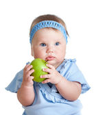 Baby girl holding green apple, isolated on white — Stock Photo