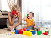 Cute mother and kid boy playing together indoor — Стоковое фото