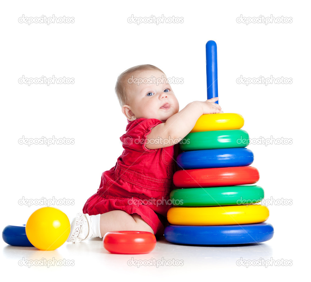 Baby girl playing with big toy isolated on white background — Stock Photo #10660964
