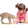 Cute kid drawing with pencils. Kitten next to girl. — Stock Photo #10722928