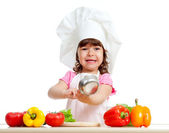 Adorable kid girl preparing healthy food — Stock Photo
