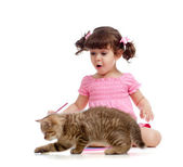 Cute kid drawing with pencils. Kitten next to girl. — Stock Photo