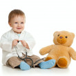 Adorable boy with clothes of doctor and teddy bear over white — Stock Photo