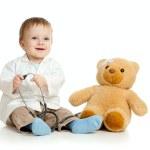 schattige jongen met kleren van arts en teddy bear over Wit — Stockfoto