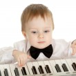 Adorable child playing electronic piano — Stock Photo