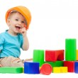 Little boy with hard hat and building blocks — Stock Photo #8717695
