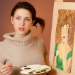 Girl painting a picture — Stock Photo