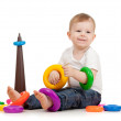Funny child playing with color toy — Stock Photo