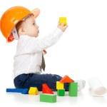 liten pojke med hjälm och teknisk ritning — Stockfoto