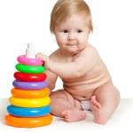 bambino che gioca con colori pyramidion — Foto Stock