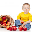 Child eating red apples with basket — Stock Photo