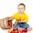 Child eating apple and basket — 图库照片