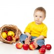 Funny child with basket filling apples — Stock Photo