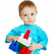 Little child with construction set over white background — Stock Photo #8718733