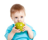 Baby boy holding and eating green apple, isolated on white — Stock Photo
