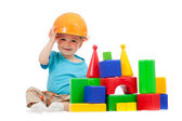 Little boy with hard hat and building blocks — Stock fotografie