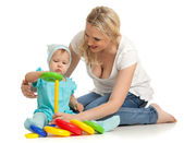 Little girl and mother with color pyramidion — Stock Photo