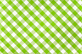 Green checked fabric tablecloth — Stock Photo