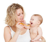 Baby's feeding by spoon — Stock Photo