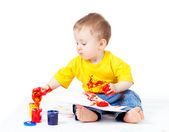 Adorable dirty child with paints — Stock Photo