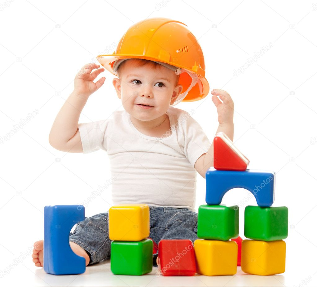Little boy with hard hat and building blocks  Stock Photo #8718164