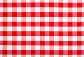 Red checked fabric tablecloth — Stock Photo