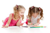 Two girls drawing with color pencils together over white — Stock Photo